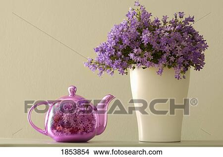 Stock Photo Of Teapot And Flowers In A Vase 1853854 Search Stock