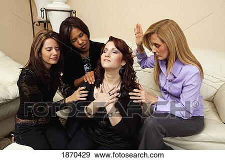 Stock Photograph Of Women Praying For A Friend 1870429 Search