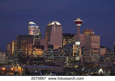 Calgary Skyline At Dawn With City Lights And Deep Blue Sky With Buildings Reflecting The Orange Glow Of Sunrise Calgary Alberta Canada Stock Photo
