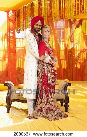 a48e1737dffc5 Picture - Portrait of a mixed race couple on their wedding day in traditional  indian garments