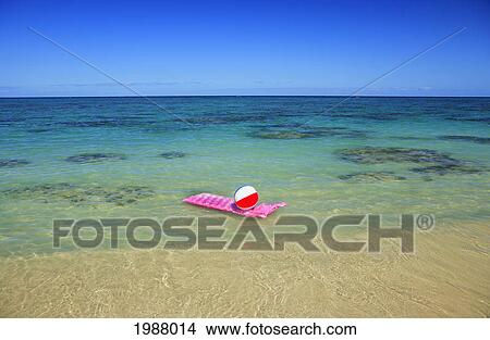 beach ball in ocean. Pink Inflated Raft And Beachball On Clear Ocean Water. Beach Ball In
