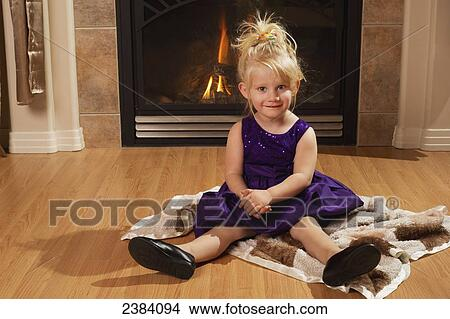 Stock Photo Of A Young Girl Wearing A Formal Dress Sits On A Blanket