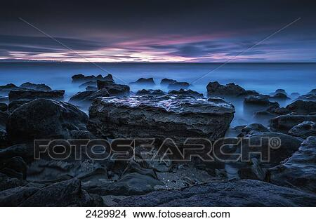 39dbc72304 Clouds glowing at sunset over the ocean from the rocky coast; Tarifa,  Cadiz, Andalusia, Spain Picture