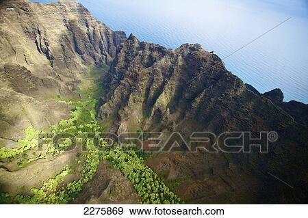 Aerial View Of The Rugged Landscape Along The Coast Of A Hawaiian