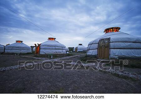 Mongolian Gers (yurts) tourist accommodation at the Ongiin Nuts Ger Camp at  dusk, Saikhan-Ovoo, Dundgovi Province, Mongolia Picture
