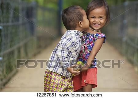 Stock Photography Of Young Boy Kissing A Young Girl Battambang