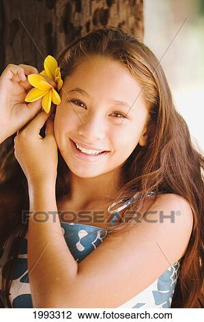 Young Hapa Hawaiian Girl Holding Flower Stock Image 1993312 Fotosearch