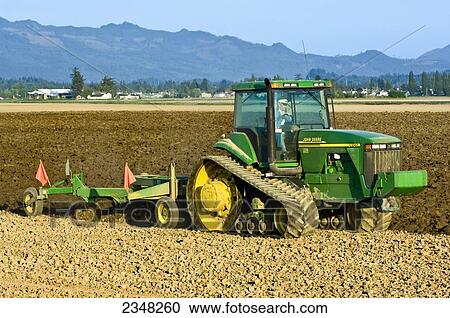 Stock Photography of Agriculture A John Deere tracked tractor