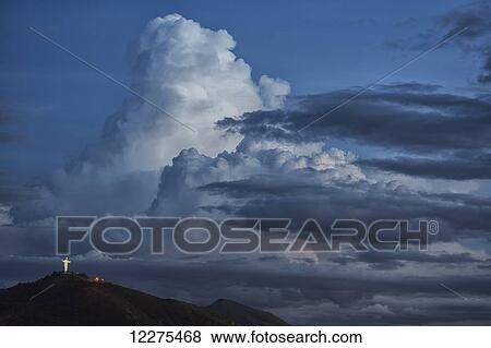 pictures of thunderheads or cumulo nimbus clouds build up over the