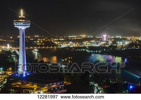 Night View Of American Falls And Lights Of The City With