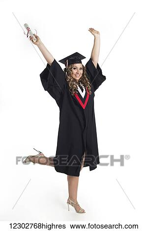 075c0f4500e Stock Photograph - Young woman graduate holding her diploma up in  celebration of her graduation