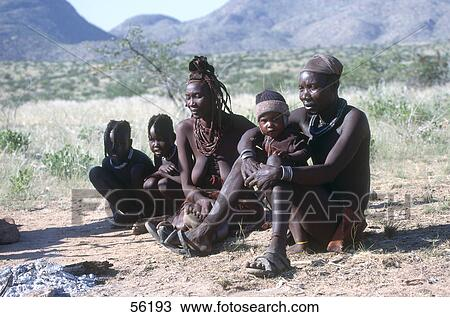 Village children carrying water in the rural Himba village
