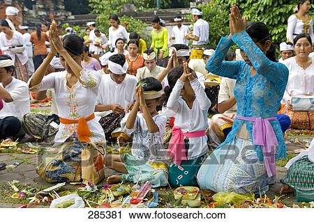 Group Of Native Balinese People Making Religious Offering