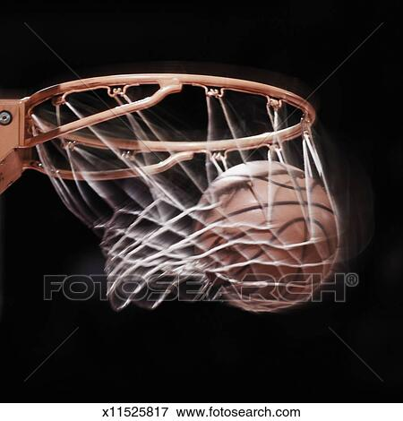 picture of basketball going through basket blurred motion