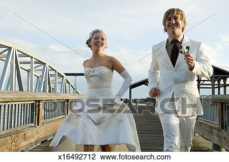 Miraculous Young Bride And Groom Running On Dock Portrait Stock Image Download Free Architecture Designs Scobabritishbridgeorg