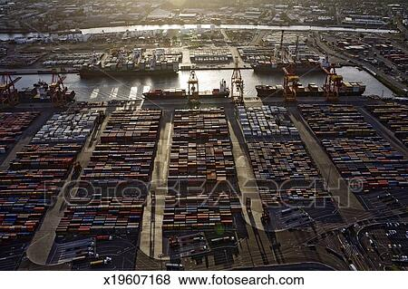 Picture   Shipping Container Storage Yard With Ships Loading In Background,  Sunset, Aerial View