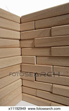 Wall corner made of wooden bricks Stock Photo