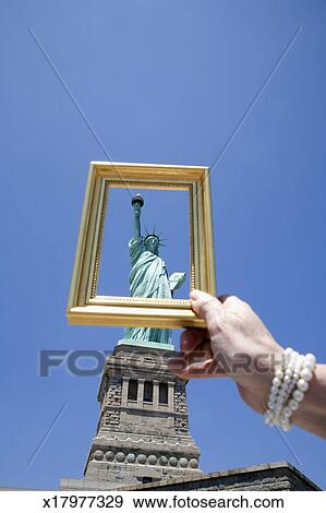 Stock Photograph Of Usa New York Woman Holding Picture Frame In