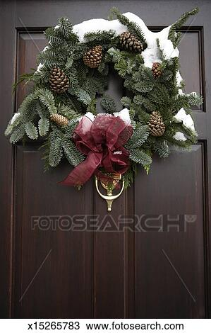 Stock Photo Of Christmas Wreath Tied With Red Ribbon On Front Door