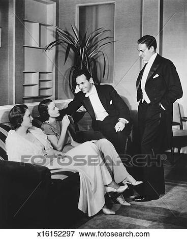 People In Evening Wear Talking Living Room BW