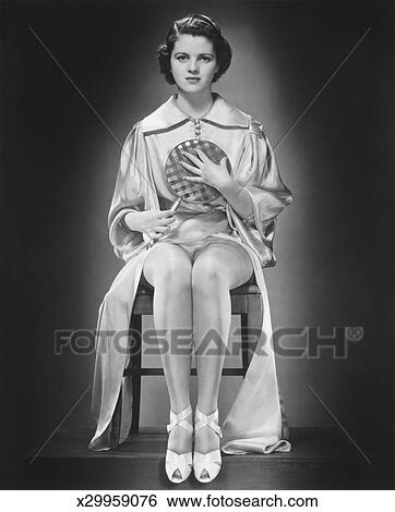 woman holding hand mirror. Woman In Silk Bathrobe Holding Hand Mirror (B\u0026W), Portrait