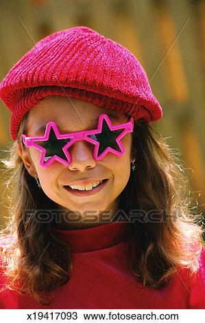 8fe8b7b8699 Little girl wearing star sunglasses Stock Photo x19417093