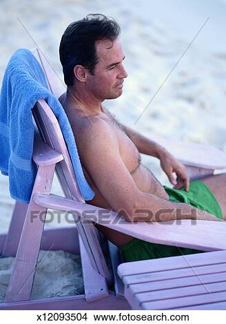 Fabulous Lounging In Beach Chair Picture X12093504 Fotosearch Ocoug Best Dining Table And Chair Ideas Images Ocougorg
