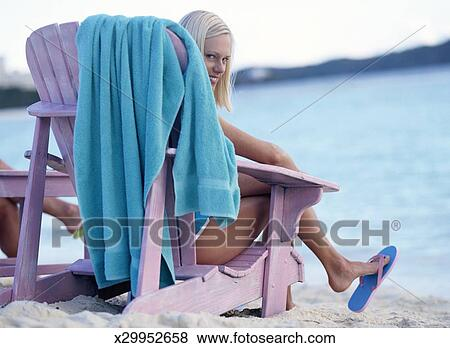 Stupendous Lounging In Beach Chair Stock Photo Ocoug Best Dining Table And Chair Ideas Images Ocougorg