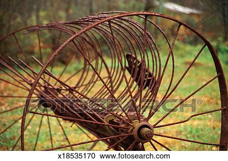 Rusted farm equipment, hay baler Stock Image