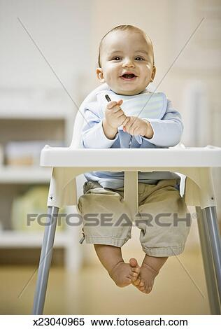 Baby 6 11 Months Sitting In High Chair Portrait Stock