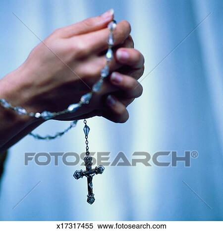 Close Up Of A Womans Hands Praying With Rosary Beads Stock Image