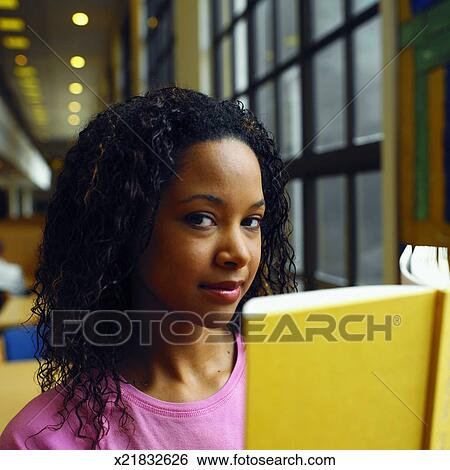 Front View Portrait Of Young Woman Holding Book Stock Photograph