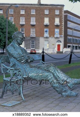 Statue Of An Old Man Sitting On A Park Bench Stock Photo X18889352