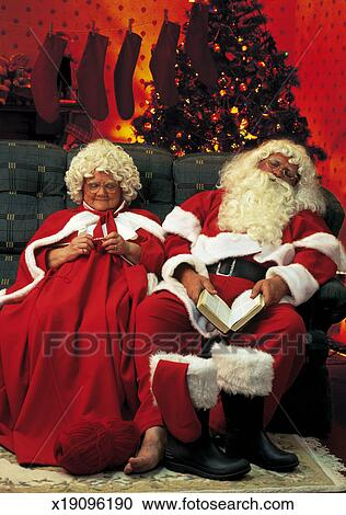 Portrait Of Santa And Mrs Claus Relaxing On The Couch