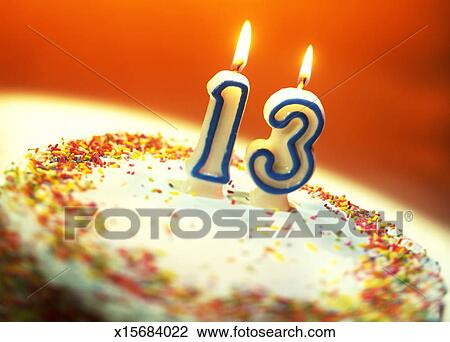 Close Up Of A Birthday Cake With 13 Candle On It
