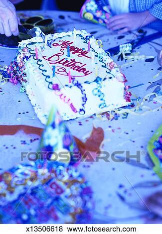 High Angle View Of A Birthday Cake Kept On Table