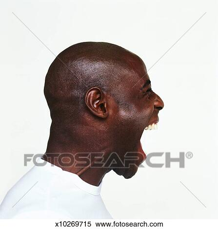 stock image of side profile of a young man screaming x10269715
