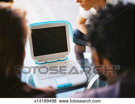 pictures of close up from behind of people viewing a laptop computer