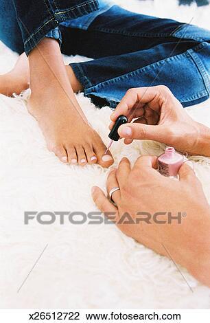A Man Painting Womans Toenails