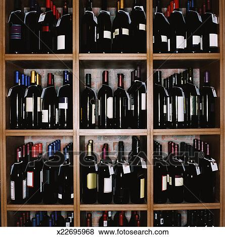 Pictures Of An Array Of Wine Bottles Kept On Display In Shelves