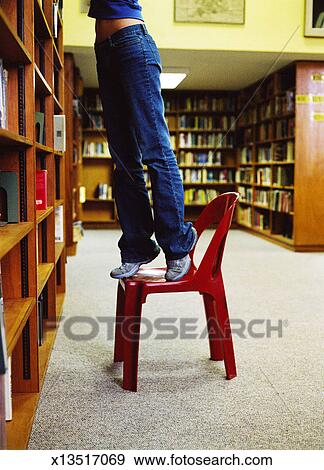 Stock Photograph of view of a person standing on a chair ...