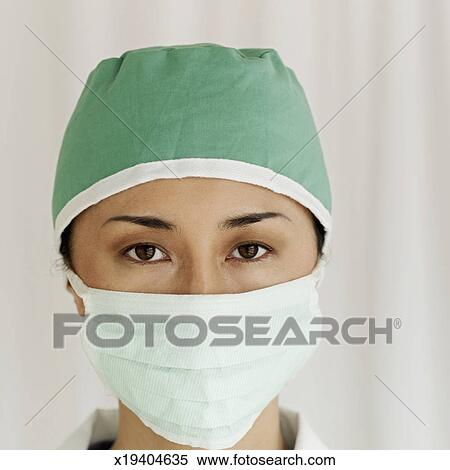 Female Photography Surgeon Of Wearing Surgical Portrait A Mask Stock