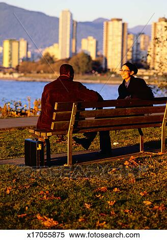 Stock Image Of Two People Sitting On A Park Bench X17055875 Search