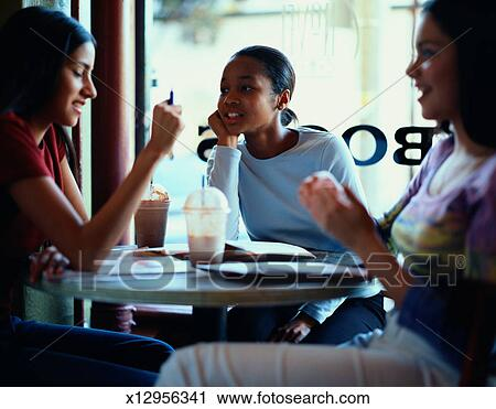 Stock Photography   Teenage Girls Talking In A Coffee Shop. Fotosearch    Search Stock Photos