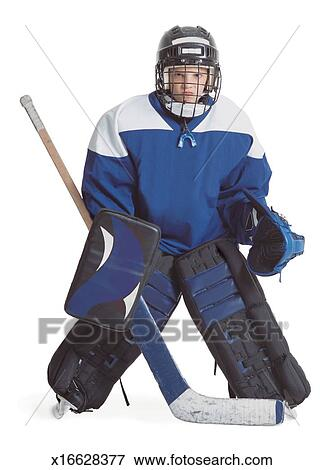 Picture Of A Little Caucasian Boy Dressed In A Hockey Uniform Stands