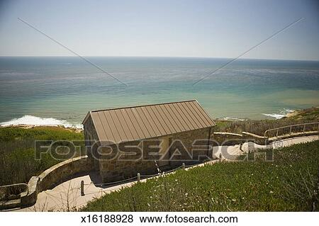pictures of high angle view of a stone cottage on a waterfront rh fotosearch com