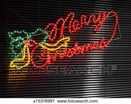 Picture Of Merry Christmas Neon Sign Hanging On Window