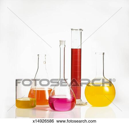 stock images of scientific measuring beakers with colorful liquid