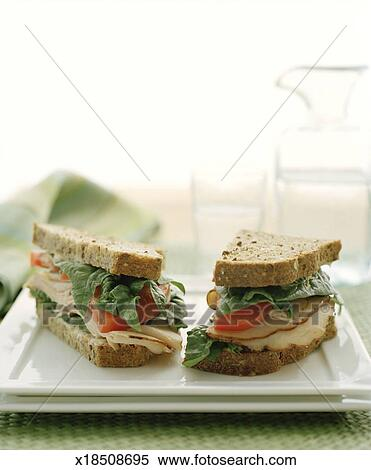 Stock Image Of Turkey Sandwich On White Plate With Water In Back