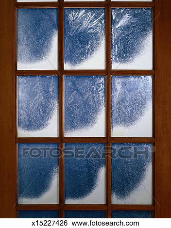 stock images of snow and frost on window pane x15227426 search